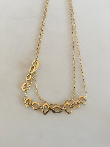 Georg Jensen Lina Falkesgaard 18K Gold Collier ornamented with 10 diamonds.
