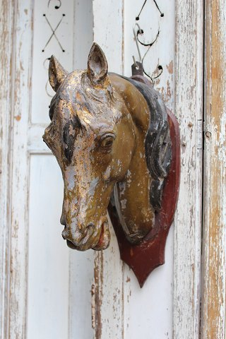 1800th century horse head in painted zinc from an old butcher shop in the south of France.