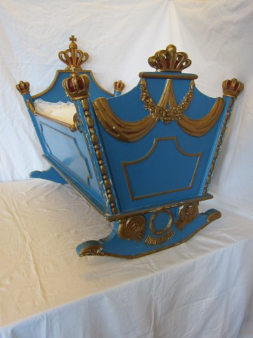 Cradle made of blue-painted and partial gilt wood. Originally intended for the princess Anne-Marie of Denmark, sister to her majesty the Queen Margrethe II of Denmark. Made in 1946 by a master cabinetmaker from Copenhagen.