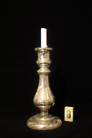 Large 1800 century candlestick in mercury glass with a fine patina. Height: 31cm.