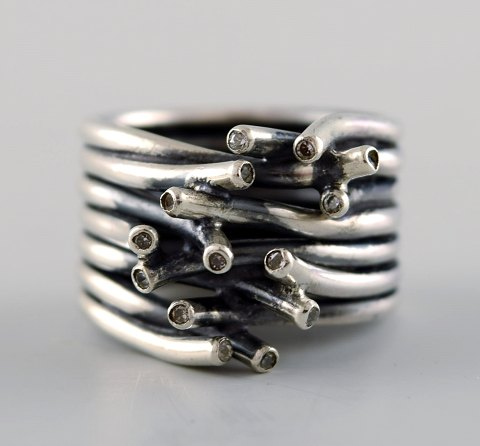 Swedish modernist sterling silver ring with many small stones.