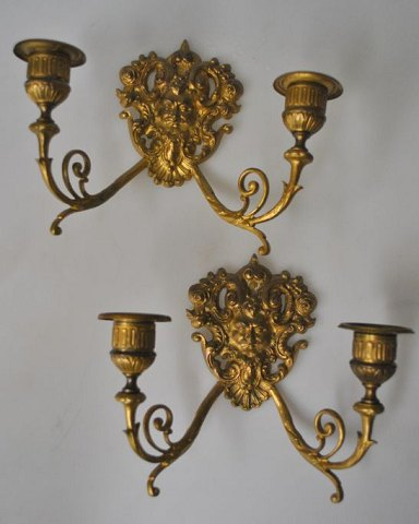 Pair of French gilded wall hangers, 19th century