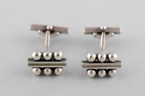 A pair of Georg Jensen art deco cufflinks in sterling silver. 1915-1930. Model number 61.