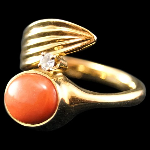 3cca3b6a40f Ole Lynggaard; A ring of 14k gold with a coral and a diamond