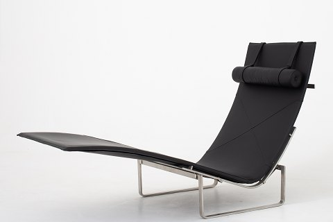 Poul Kjærholm / Fritz Hansen PK 24 chaise lounge in original black leather w. neck cushion and frame in steel. 1 pc. in stock Good condition Location: KLASSIK Flagship Store - Bredgade 3, 1260 KBH. K.