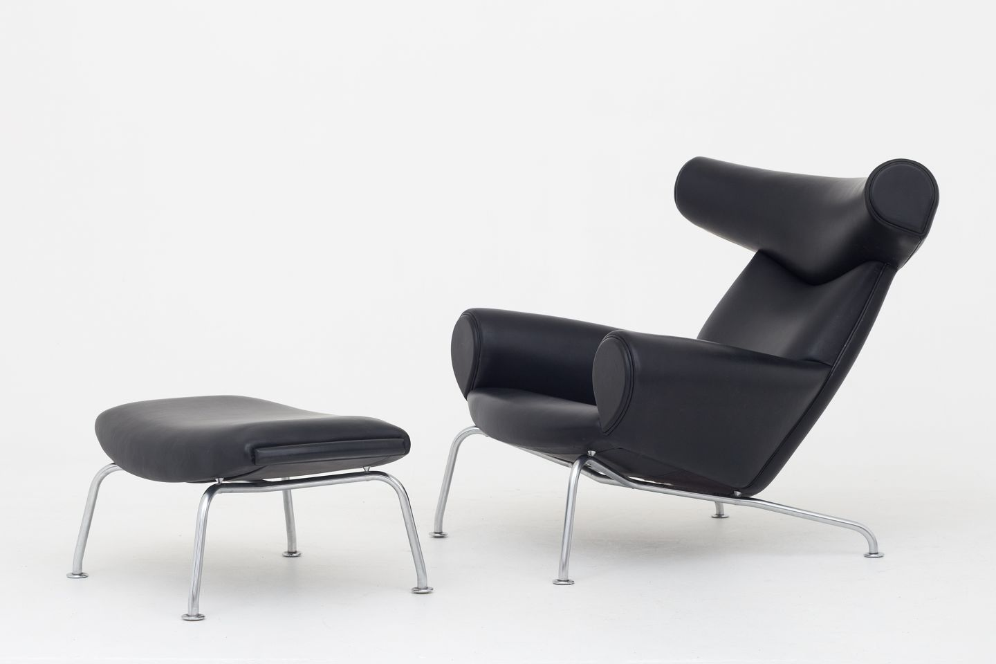 Hans J. Wegner / Erik Jørgensen EJ 100   Ox Chair Lounge Chair W. Footstool  In Black Leather And Steel Legs 1 Set In Stock. Good Condition